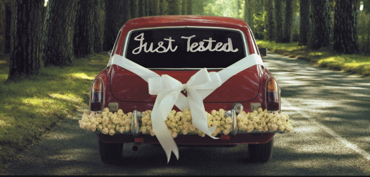 """Wedding car with message """"Just Tested"""" on back window"""